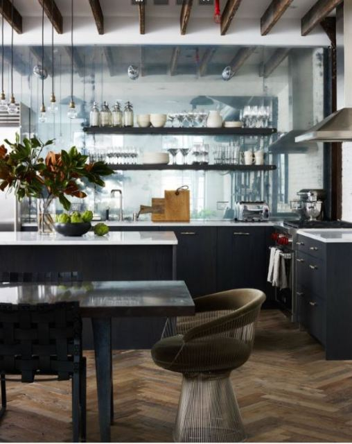 Open plan kitchen with a Platner chair and pendant lights