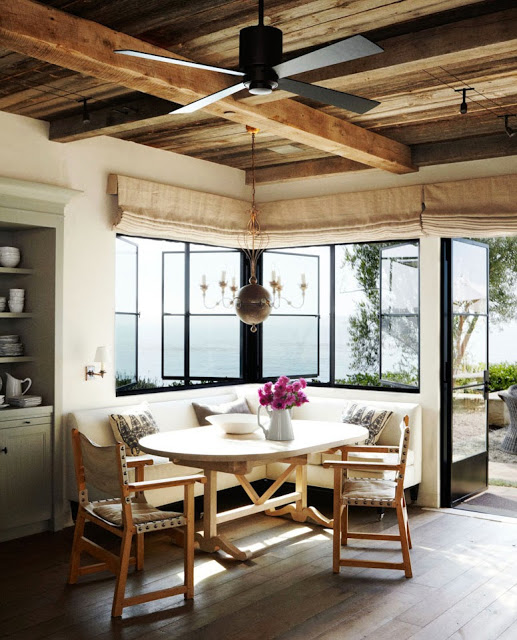 Breakfast nook with exposed beams and built in banquette seating