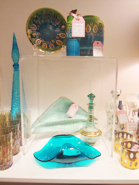 Display of carefully curated vintage dishes, plates and other glassware