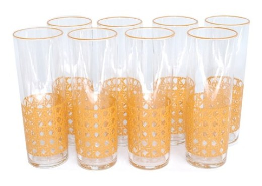 8 vintage glasses with orange cane pattern on the bottom third and orange rims