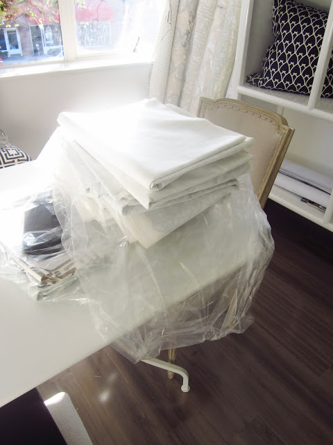 Stack of COCOCOZY Light fabrics with the design folded so the pattern can't be seen