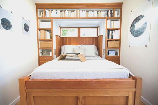 Small bedroom in a beach cottage with built in bed and book shelves