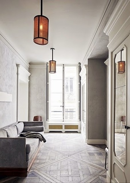 Neutral living room with decorative molding in a Paris home by Joseph Dirand