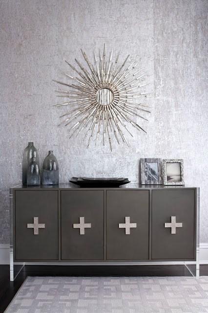 Modern charcoal grey buffet with a silver sunburst mirror