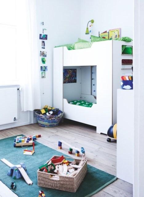 Bight kids bedroom with bunk beds and hardwood floor