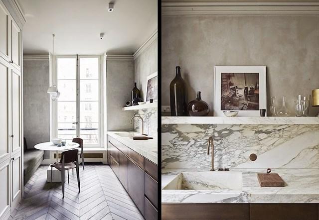 Kitchen in a Paris home by Joseph Dirand with herringbone wood floors and marble backsplash