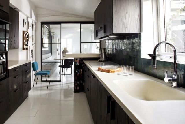 Dark wood and white kitchen in a Paris apartment
