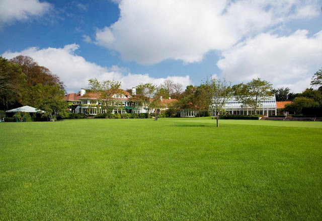 exterior photo of the grounds of a Hamptons mansion
