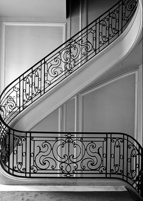 Beautiful black staircase in a Paris home by Joseph Dirand