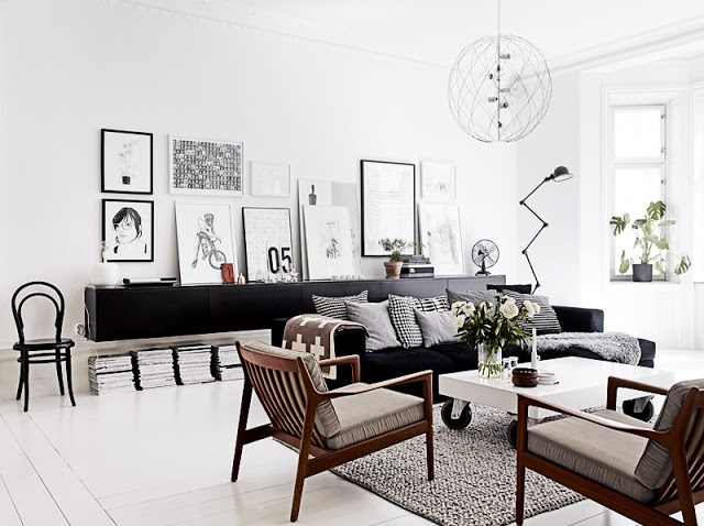 black white living room decor interior design chairs mid century modern bo concept rug sofa ikea floating cabinet picture gallery wall