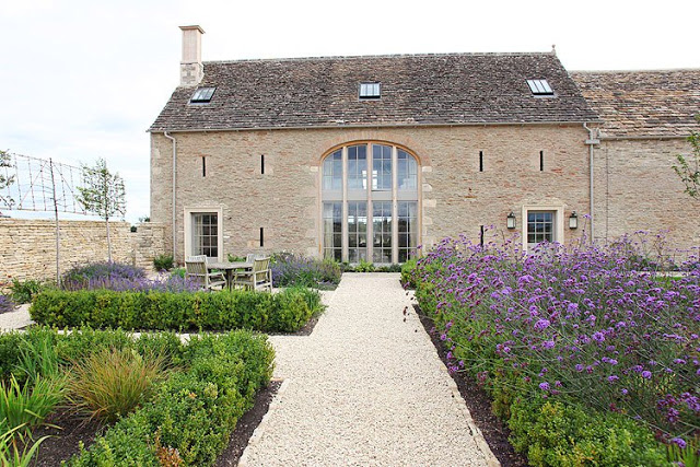 exterior of British Barn conversion with garden