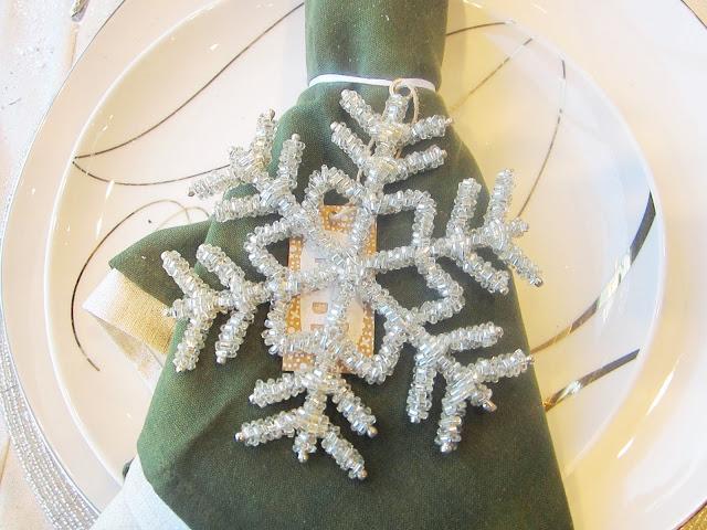 Beaded snowflake napkin ring on a green napkin