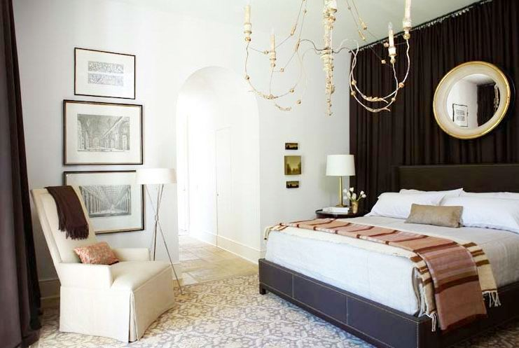 Bedroom with a wall of drapes doubling as a headboard