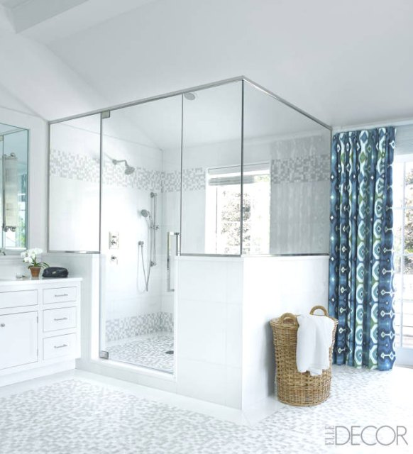 Bathroom with grey tile and large shower
