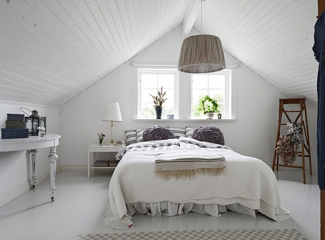 White mater bedroom in a Swedish cottage pitch ceiling painted wood floor pendant light