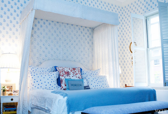 Rebecca de Ravenel's bedroom after being redecorated with walls covered in Quadrille blue and white paisley and a canopy bed