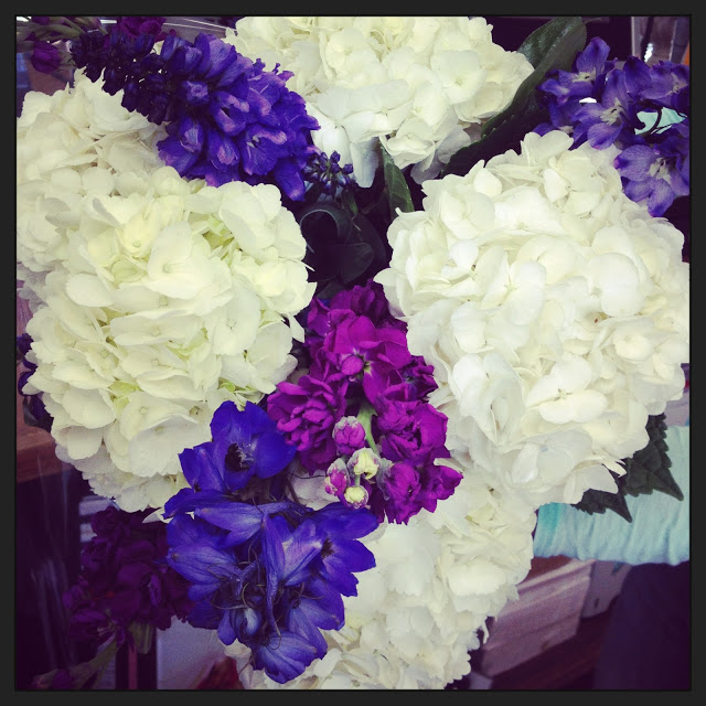 flower arrangement with white and purple hydrangeas