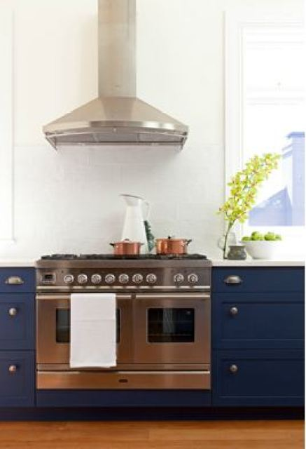 arent pyk's navy and white kitchen counters with stainless steel hood and recycled reclaimed wood floors