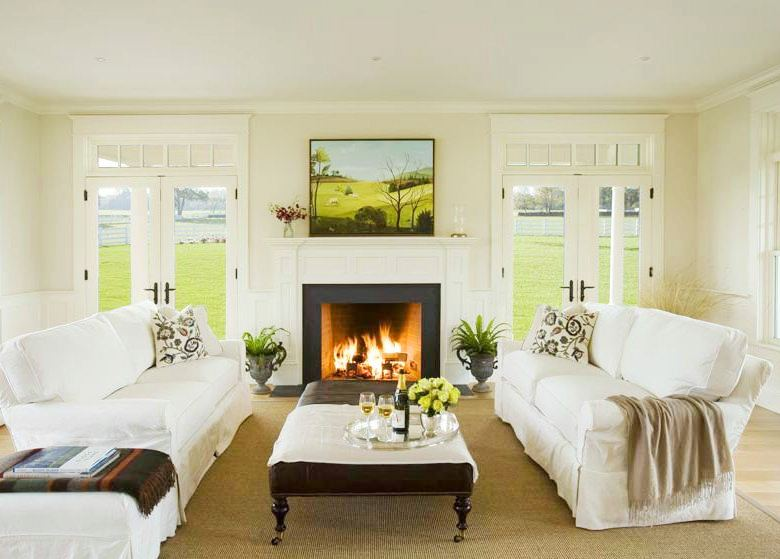 Traditional Living Room With Dueling Sofas, A Fireplace With A Landscape On  The Mantel,