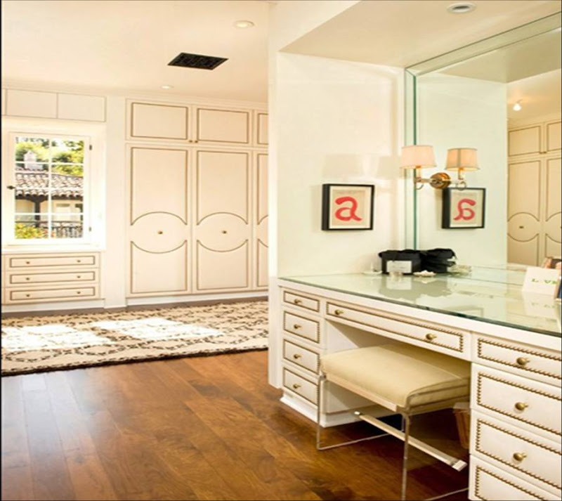 Dressing room by Todd Nickey and Amy Kehoe with nail head trim on the closet doors and vanity drawers