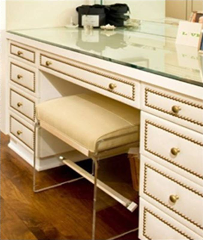 Close up of built in vanity drawers in a dressing room by Todd Nickey and Amy Kehoe with nailhead trim