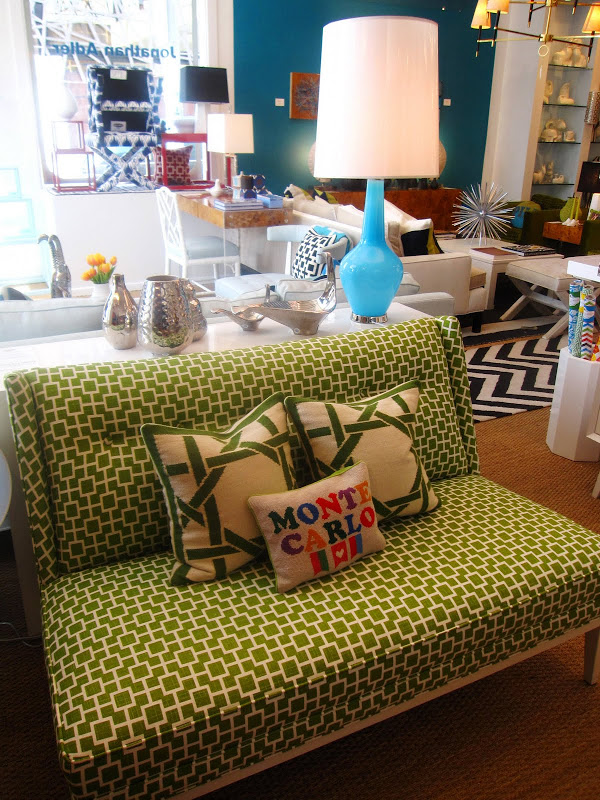 Jonathan Adler Capri Bottle lamp and a green and cream graphic print sofa