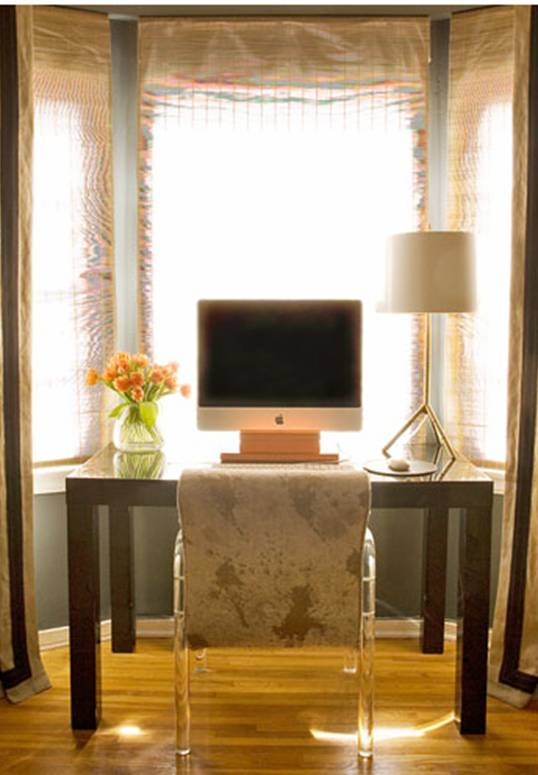 Home office and study by Kristen Hutchins with blue grey walls, gold desk lamp, sheer curtains and a dark wood parsons desk