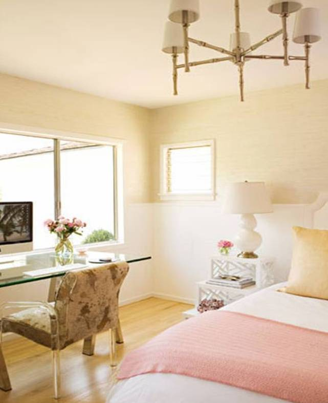 Bedroom by Kristen Hutchins with gold faux bamboo metal chandelier, glass desk and picture window