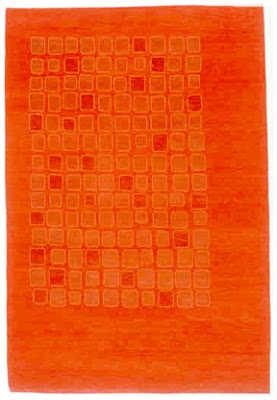 Orange wool rug from Elso & Company