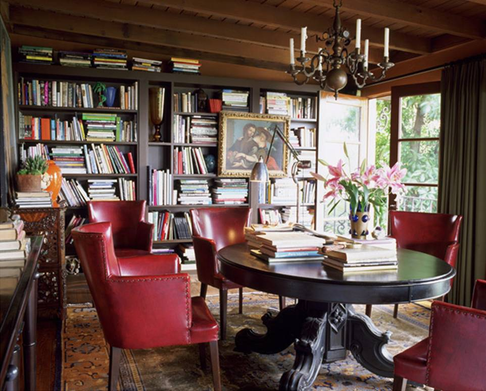 Attractive Library With Dark Wood Pedestal Table, Red Leather Chairs And Dark Wood  Built In Bookcases
