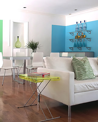 Bright modern living and dining room designed by Vanessa de Vargas with blue and green blocks of color on white walls