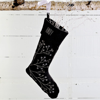 Black stocking with a beaded branch from West Elm