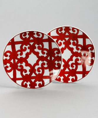 Two red and white Hermes porcelain dessert plates from Bluefly