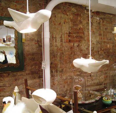 Two white ceramic bird pendant lights from ABC Carpet & Home