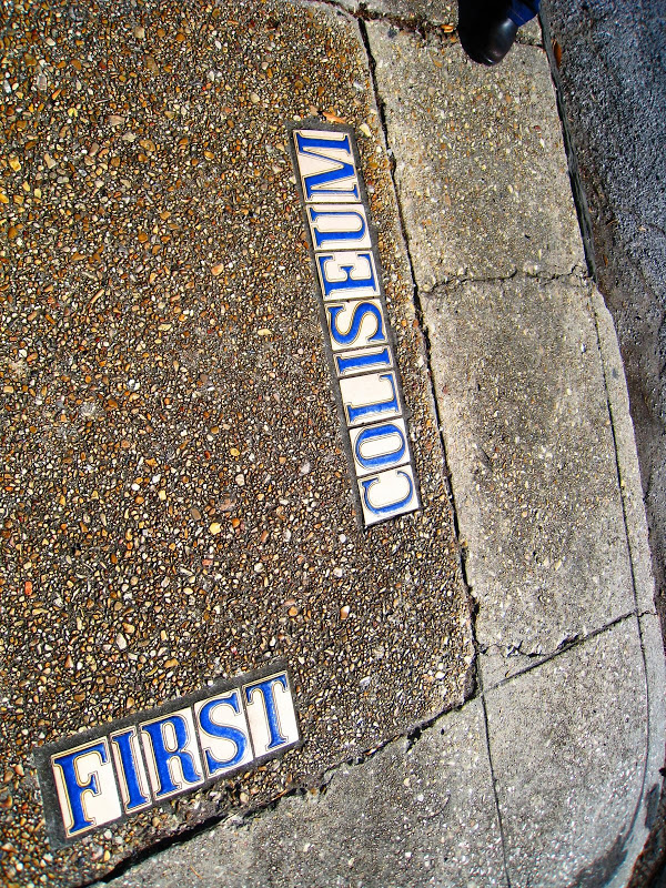 Tile street markers on a sidewalk in New Orleans