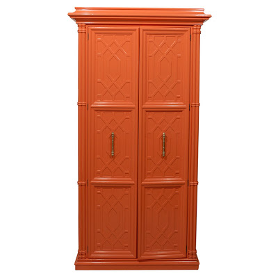 Vintage newly painted fretwork orange cabinet from Pieces Inc