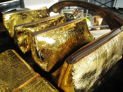 Metallic gold make up cases from Persimmon