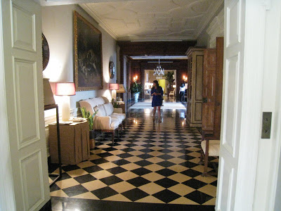 Black and white checkered marble floor is laid on a diagonal in the Grand Hall of the Greystone Mansion