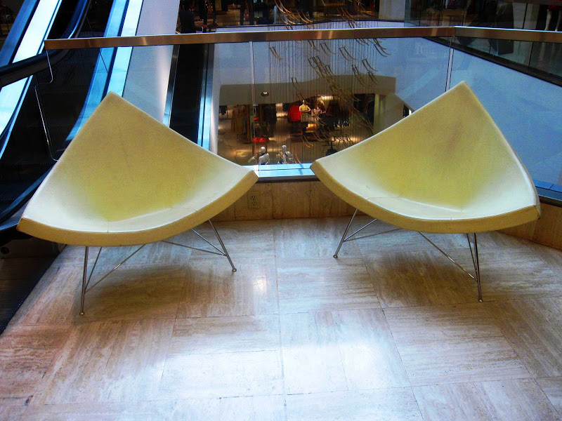 Two white leather futuristic chairs in Neiman Marcus