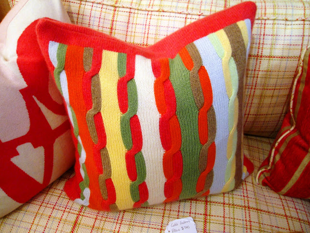 Multicolored cable knit cashmere throw pillow inside the Elizabeth Bauer store