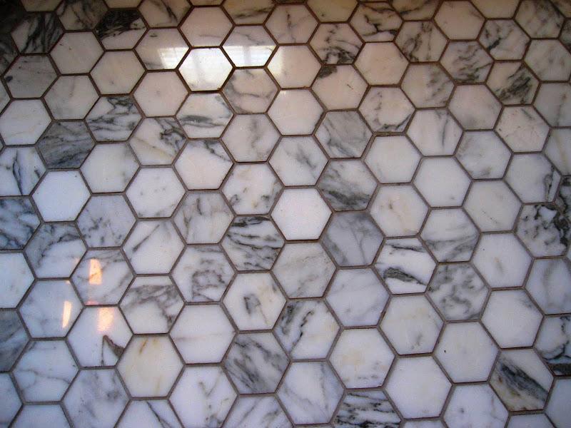 Hexagon Cararra marble mosaic floor in a bathroom by Newman & Wolen Design