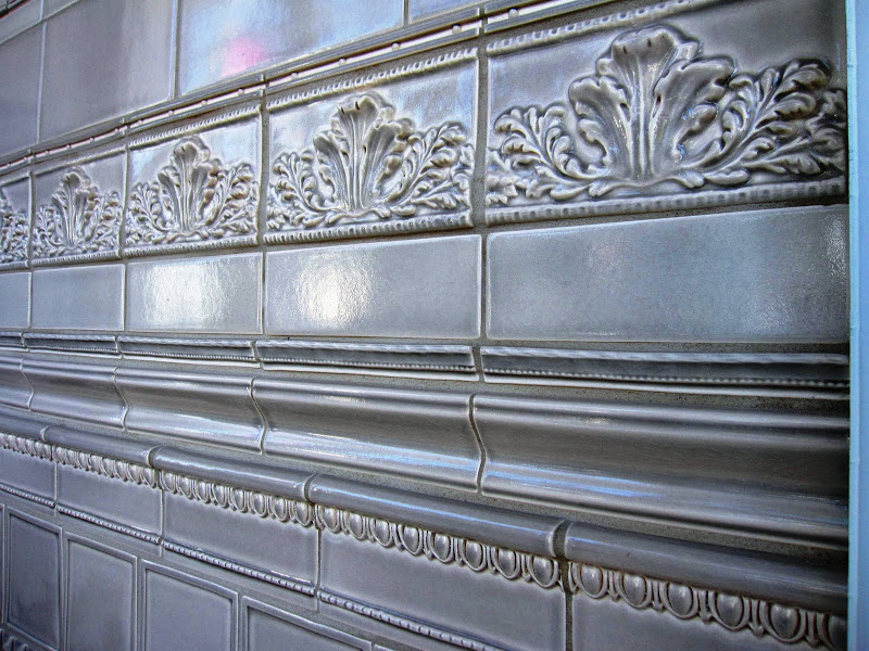 Close up of a ceramic tile liners and trim pieces in a bathroom