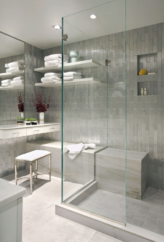 Sleek sliver bathroom with glass shower, vertical subway tile walls and marble tile floor