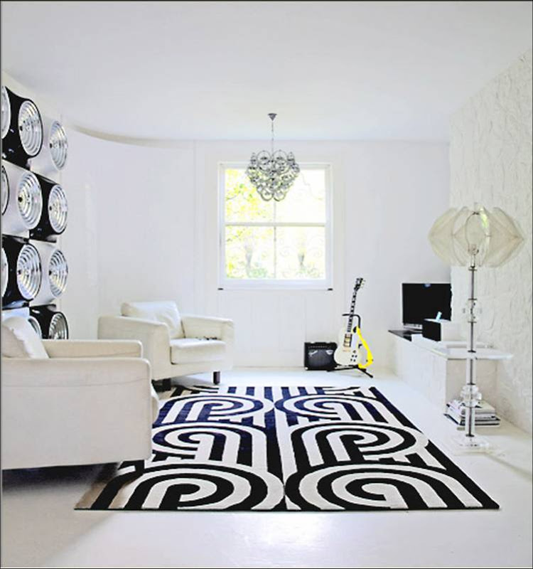 White living room with a graphic black and white rug from Knots Rug, Ltd