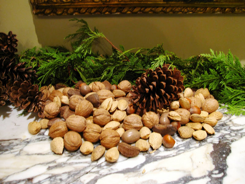 Fireplace in the men's parlor of a historic New Orleans mansion with a garland made of fresh pine, pine cones and nuts