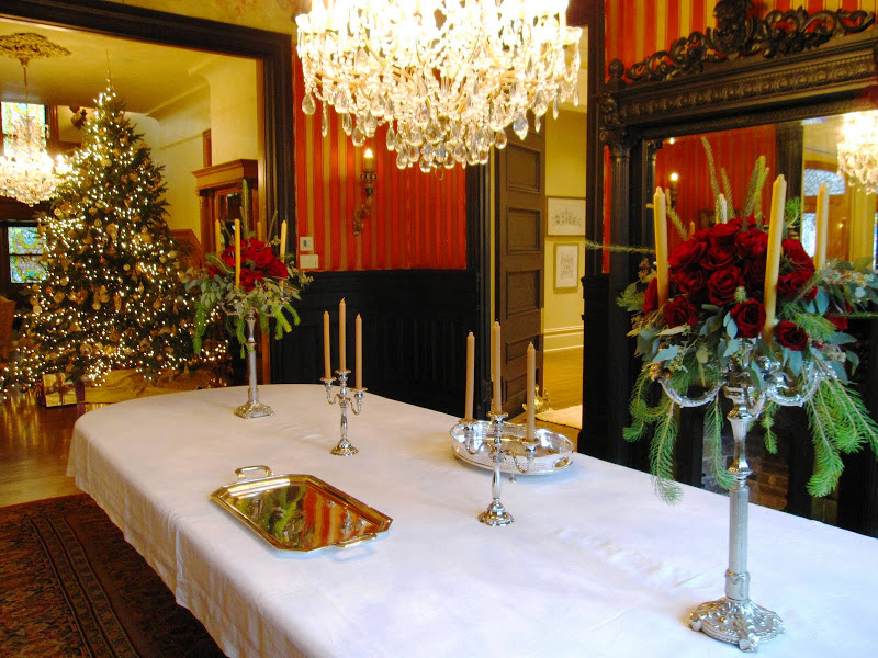 Rose filled candelabras on the dining room table before a party in a historic New Orleans mansion