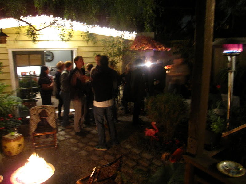 People mingling at a garden party in Venice Beach, CA
