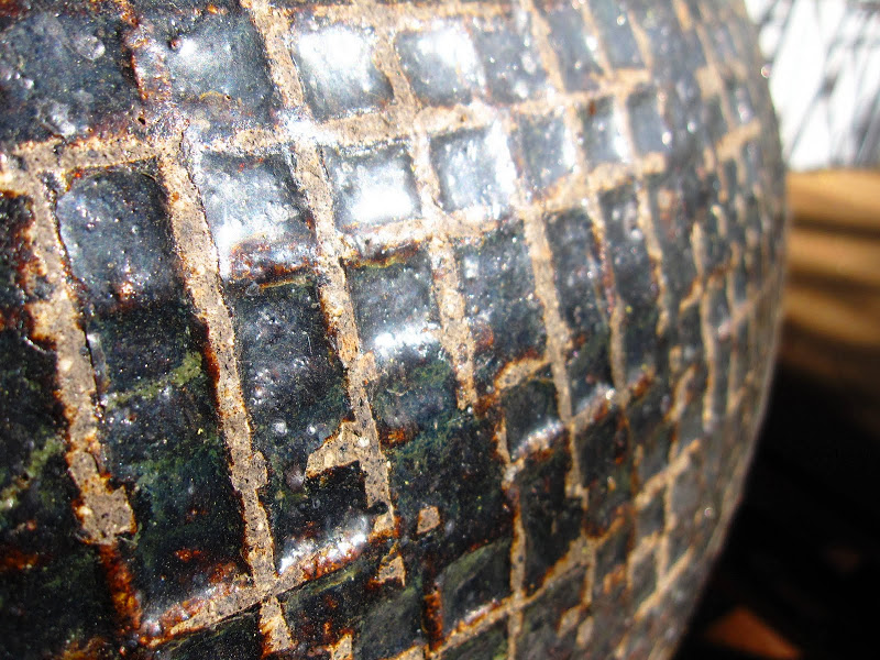 Close up of the woven detail on pots on a deck in the Hollywood Hills