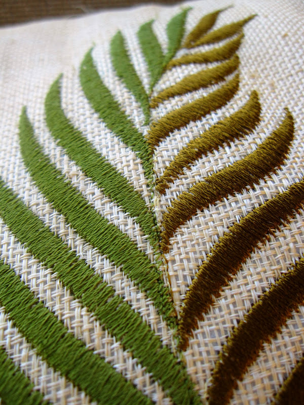 Close up of embroidery on a leaf on an outdoor accent pillow on a deck in the Hollywood Hilss