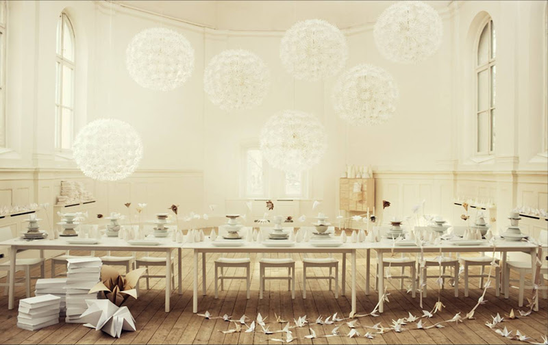 Dandelion ceiling lights in a dining room with paper decorations and accents